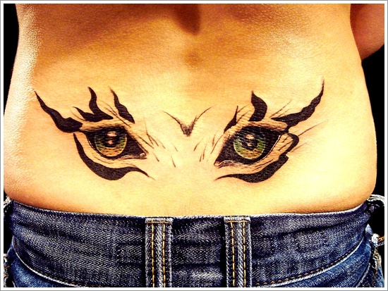 Attractive eyes tattoo on lower back for Cat eyes tattoo designs