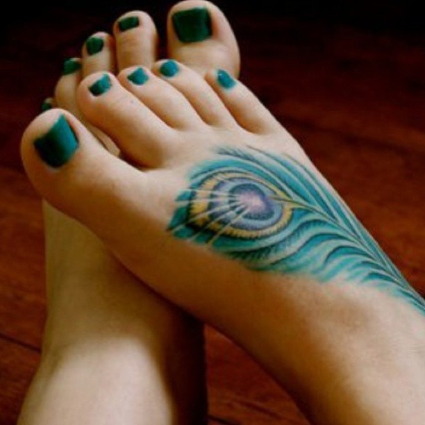 Peacock feather tattoo meaning and design guide for Feather on foot tattoo